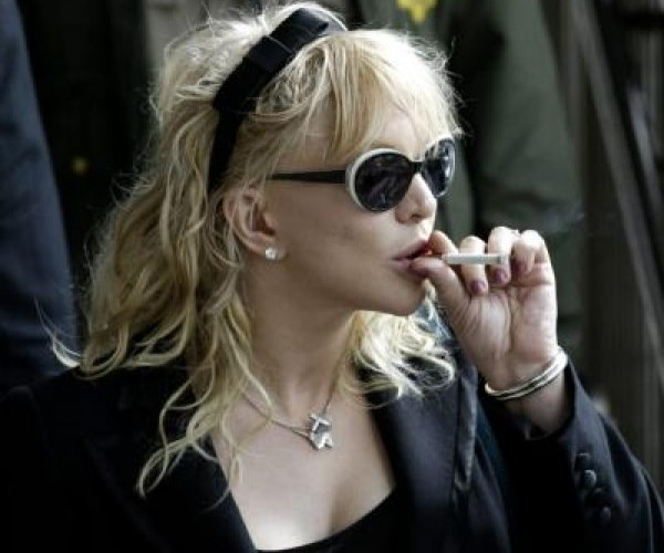 Singer Courtney Love exits Los Angeles Superior Criminal Division