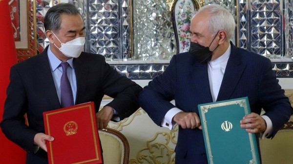 Iran-NL Chinese Foreign Minister Wang Yi and his Iranian counterpart, Mohammad Javad Zarif, signed the deal